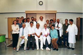 Dr Toshikatsu Yamamoto and his wife with participants at a seminar for doctors at Miyazaki, Japan, in October 2003.