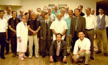 Dr Toshikatsu Yamamoto and his wife with participants at a seminar for doctors at Miyazaki, Japan, in October 2004.